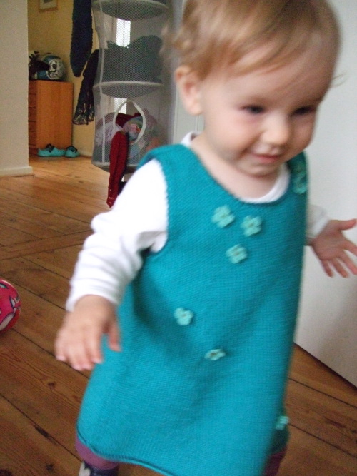 Little knitted turquoise dress