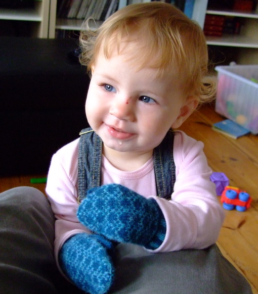 Baby Girl models her first real mittens