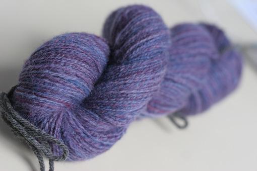 Shetland fiber spun on supported spindles.