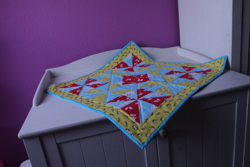 Baby's quilted play blanket